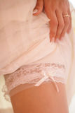 Bride garter. Bride wedding garter on leg Stock Images