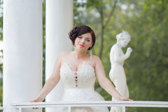 The bride in the gazebo. Beautiful bride in the gazebo Royalty Free Stock Photos