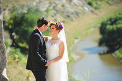 Bride Gently Looking at Groom. At sunny day Royalty Free Stock Images