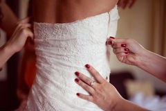 Bride geting her dress on Royalty Free Stock Photo