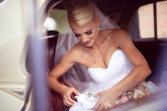 Bride geting off the car Royalty Free Stock Photo