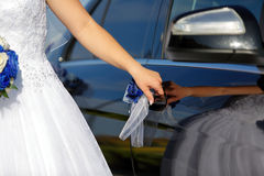 Bride gets into the car Stock Photo