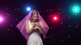 Bride gets gift at bachelorette party. Slow motion. Bride gets gift at bachelorette party, black background and stroboscope lamps provide beautiful lighting stock video