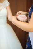Bride getting bracelet dressed Stock Photos