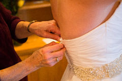Bride Getting Dress On Royalty Free Stock Image