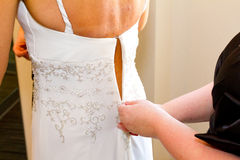 Bride Getting Dress Zipped Up Royalty Free Stock Image