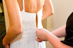 Bride Getting Dress Zipped Up Stock Images
