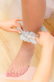 Bride getting dressed Royalty Free Stock Photo