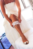The bride getting dressed Stock Photography