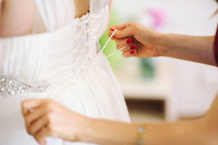 Bride getting dressed Royalty Free Stock Image