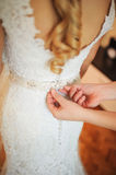 Bride getting dressed Royalty Free Stock Photos