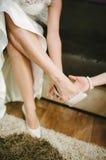 Bride getting dressed Stock Image