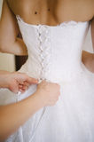 Bride getting dressed Stock Photo