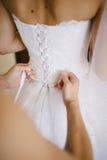 Bride getting dressed Stock Photos