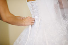 Bride getting dressed on her wedding day Royalty Free Stock Photos