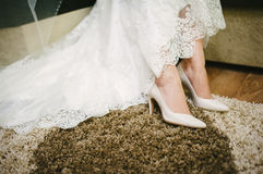 Bride getting dressed shoes on her wedding day Royalty Free Stock Photography
