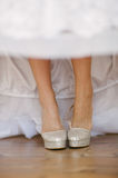 Bride getting dressed shoes on her wedding day Stock Photo