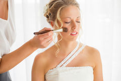 Bride getting her makeup fixed Royalty Free Stock Images