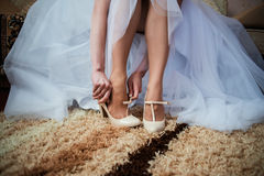 The bride getting her wedding shoes on Stock Photos