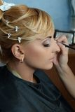 Bride getting make up on Royalty Free Stock Photography