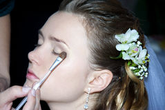 Bride getting make up on Royalty Free Stock Photos