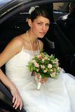 Bride Getting Out of Car Stock Image