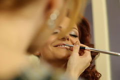 Bride getting professional makeup Stock Photo