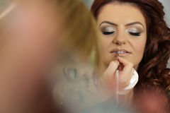 Bride getting professional makeup Royalty Free Stock Photo