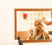 Bride getting ready for wedding in hair dressing Stock Photography