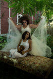 Bride and girl Stock Image