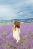 Bride girl is running at lavender field Royalty Free Stock Image