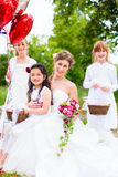 Bride with girls as bridesmaids, flowers and balloons Royalty Free Stock Photography