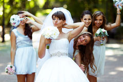 Bride and girls have fun while walking in the park Royalty Free Stock Photo