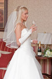 Bride with glass Royalty Free Stock Image