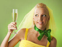 Bride with a glass of champagne Stock Images