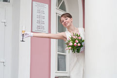 Bride with glass of wine Royalty Free Stock Photos