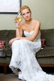 The bride with a glass of wine Royalty Free Stock Photo