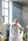 Bride goes near the window. MOSCOW - MARCH 10: bride goes near the window during orthodox wedding ceremony on March 10, 2013 in Moscow Royalty Free Stock Image