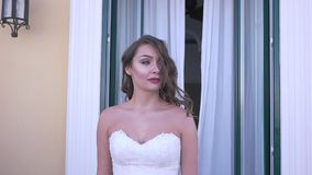 The bride goes to the balcony stock video footage