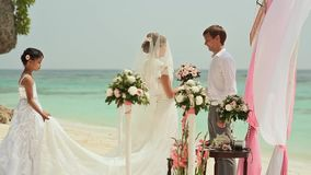 The bride goes to the groom on the beach. Wedding ceremony at the beach of the Philippines. stock video footage