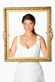 Bride with golden frame Royalty Free Stock Photos