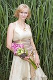 Bride in golden wedding dress Stock Photography