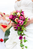 Bride in gown with bridal bouquet and doves Stock Photo