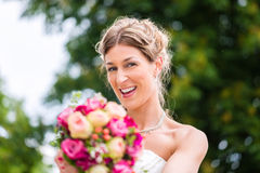 Bride in gown with bridal bouquet Royalty Free Stock Image
