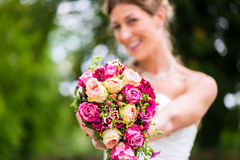 Bride in gown with bridal bouquet Stock Photography