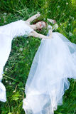 Bride on grass Royalty Free Stock Photography
