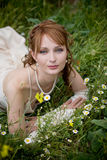 Bride on grass Stock Photo