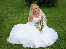 Bride on the grass Stock Photos