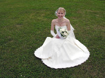 Bride on grass. Bride on green grass royalty free stock photo