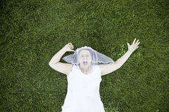 Bride on grass Stock Images